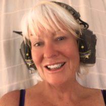 Deirdre on site, with headphones